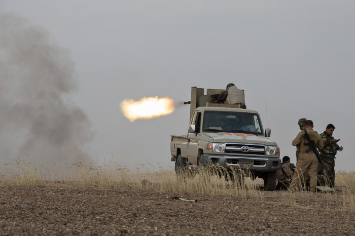 30/09/2015. Kirkuk, Iraq. A member of the KDP peshmerga fires a KPV 14.5mm heavy machine gun at ISIS positions in the village of Mansuriya, during a peshmerga offensive against Islamic State held villages west of Kirkuk, Iraq. Supported by coalition airstrikes around 3500 peshmerga of the Patriotic Union of Kurdistan (PUK) and the Kurdistan Democratic Party (KDP) engaged in a large offensive to push Islamic State militants out of villages to the west of Kirkuk. During previous offensives ISIS fighters withdrew after sustained coalition air support, but this time in many places militants stayed and fought. The day would see the coalition conduct around 50 airstrikes helping the joint peshmerga force to advance to within a few kilometres of the ISIS stronghold of Hawija and re-take around 17 villages. Around 20 peshmerga lost their lives to improvised explosive devices left by the Islamic State, reports suggest that between 40 and 150 militants were killed.