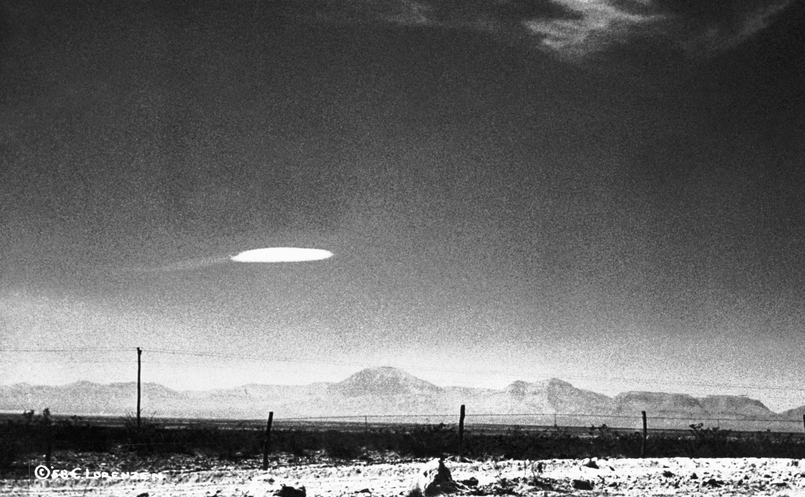 16 Oct 1957, Alamogordo, New Mexico, USA --- A UFO variety was photographed when it hovered for fifteen minutes near Holloman Air Development Center in New Mexico. The object was photographed by a government employee and was released by the Aerial Phenomena Research Organization after careful study. There is no conventional explanation for the object. --- Image by © Bettmann/CORBIS