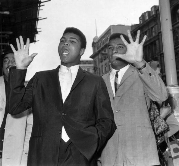 21st June 1963:  American heavyweight boxer Cassius Clay (later Muhammad Ali) with his brother Rudolph (later Rahman Ali). (Photo by Evening Standard/Getty Images)