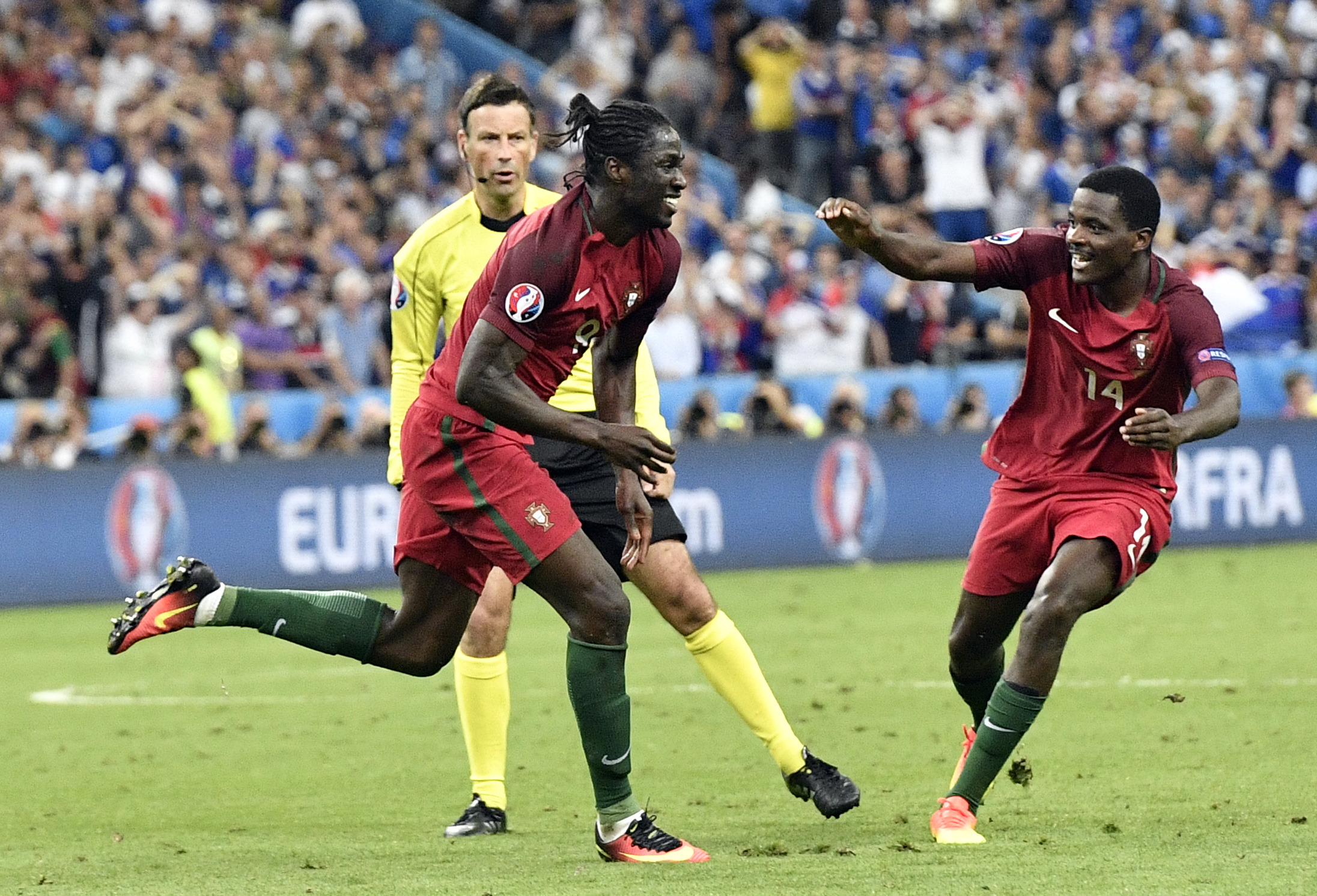 Portugal's Eder, left, celebrates after scoring the opening goal during the Euro 2016 final soccer match between Portugal and France at the Stade de France in Saint-Denis, north of Paris, Sunday, July 10, 2016. (AP Photo/Martin Meissner)
