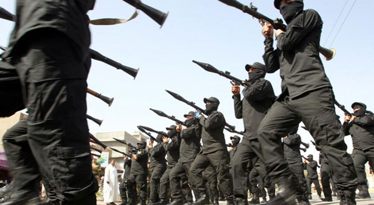 iraqi-shiite-fighters-parading-with-their-weapons-in-the-capital-baghdad-afp