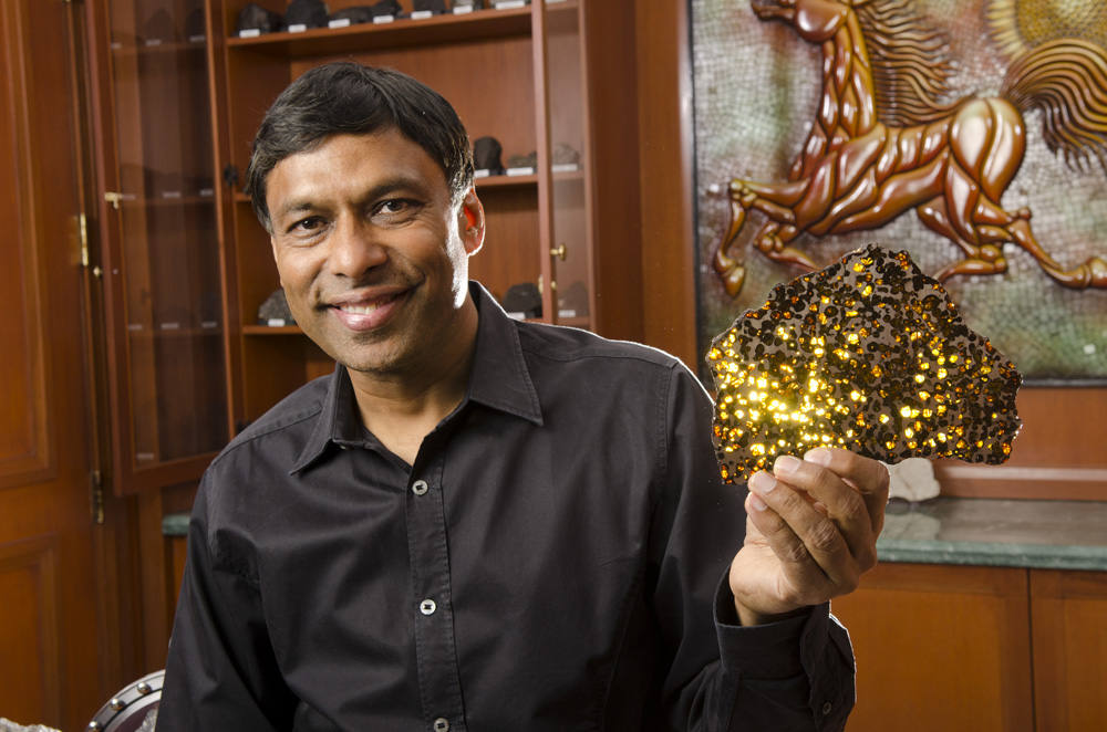 Naveen Jain, founder of InfoSpace, Intelius, Moon Express, is shown at home with his collection of meteorites. With over 500 specimens, it is one of the world's most complete meteorite collections.