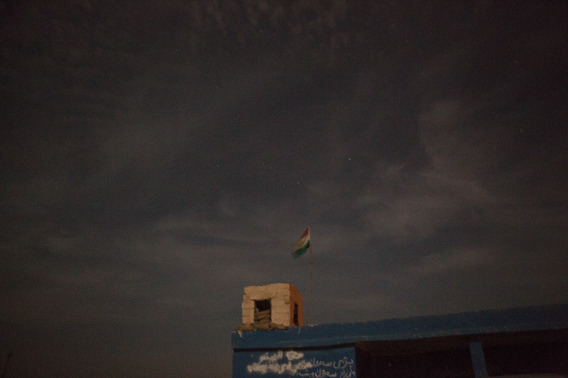 29/09/2015. Kirkuk, Iraq. The Kurdish flag flies over a small peshmerga base ahead of an offensive to retake several ISIS held villages west of Kirkuk, Iraq. Supported by coalition airstrikes around 3500 peshmerga of the Patriotic Union of Kurdistan (PUK) and the Kurdistan Democratic Party (KDP) engaged in a large offensive to push Islamic State militants out of villages to the west of Kirkuk. During previous offensives ISIS fighters withdrew after sustained coalition air support, but this time in many places militants stayed and fought. The day would see the coalition conduct around 50 airstrikes helping the joint peshmerga force to advance to within a few kilometres of the ISIS stronghold of Hawija and re-take around 17 villages. Around 20 peshmerga lost their lives to improvised explosive devices left by the Islamic State, reports suggest that between 40 and 150 militants were killed.