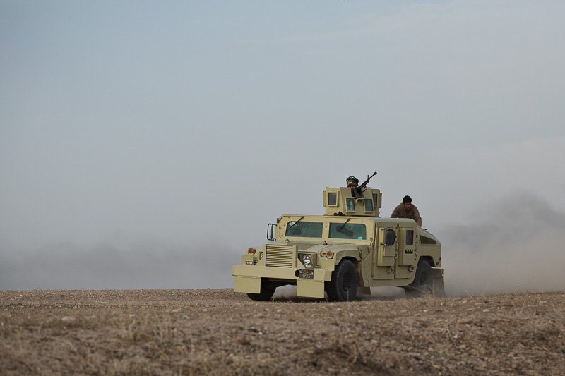 30/09/2015. Kirkuk, Iraq. An KDP peshmerga armoured Humvee, armed with a DShK 12.7mm heavy machine gun, changes position to give support to peshmerga engaging Islamic State militants holding out in the village of Mansuriya, west of Kirkuk, Iraq. Supported by coalition airstrikes around 3500 peshmerga of the Patriotic Union of Kurdistan (PUK) and the Kurdistan Democratic Party (KDP) engaged in a large offensive to push Islamic State militants out of villages to the west of Kirkuk. During previous offensives ISIS fighters withdrew after sustained coalition air support, but this time in many places militants stayed and fought. The day would see the coalition conduct around 50 airstrikes helping the joint peshmerga force to advance to within a few kilometres of the ISIS stronghold of Hawija and re-take around 17 villages. Around 20 peshmerga lost their lives to improvised explosive devices left by the Islamic State, reports suggest that between 40 and 150 militants were killed.