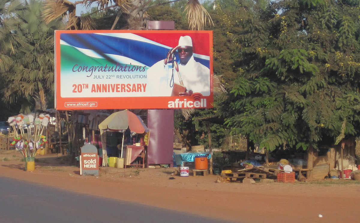 A giant billboard of Gambia President Yahya Jammeh sits on an empty street in Banjul Gambia, Wednesday, Dec. 31, 2014. Heavy gunfire rang out Tuesday near the presidential palace in the tiny West African nation of Gambia, residents said, raising the specter of a coup attempt while the longtime ruler is out of the country. Yahya Jammeh, who came to power in a 1994 coup when he was 29 years old, left the capital of Banjul for France on Saturday, state media reported. On Tuesday, soldiers linked to his presidential guard were believed to be involved in the fighting, according to witnesses who spoke on condition of anonymity for fear of reprisals. (AP Photo)