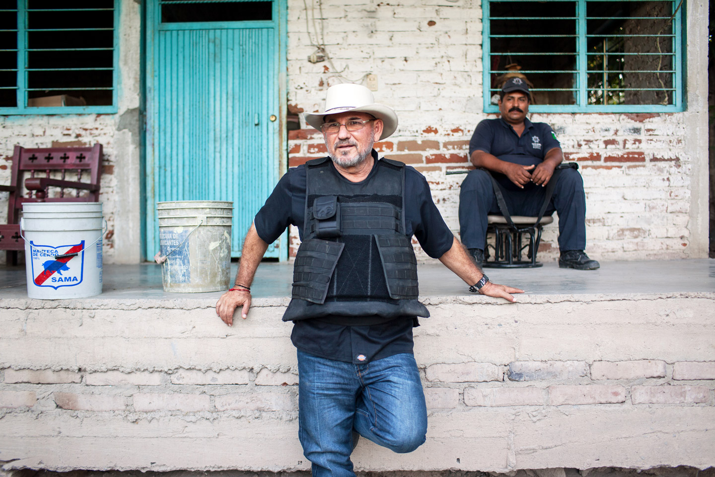 "Hipolito Mora rests at his families lime ranch in La Ruana, Michoacán, Mexico, Tuesday, December 15, 2015. Hipolito Mora was one of the original founder of the autodefensa movement, which saw vigilantes spread across the state of Michoacán and drive out the cartel group the 'Knights of Templar'. Since the uprising began in 2013, other criminal groups have filled the space of the previous cartel and many look at the autodefensa movement as a failure. Mora has had many challenges over the last three years, including being sent to jail twice and having his son killed in a shootout Dec. 16, 2014 during a shootout with a rival group. This ranch is a very important place for Mora. ""This is where I expect to die"" said Mora, motioning to the hills surrounding the ranch, which would make for a great spot for a shooter to hide. ""My son and I had plans to build up the house and make this out place, it was out dream, but that was before."" (Brett Gundlock/Boreal Collective)"
