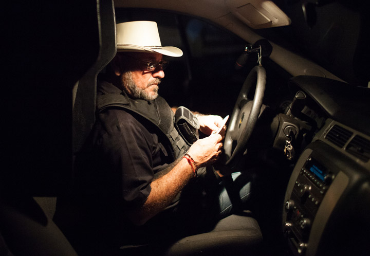 "Hipolito Mora in his bullet proof truck on his families lime ranch in La Ruana, Michoacán, Mexico, Tuesday, December 15, 2015. Hipolito Mora was one of the original founder of the autodefensa movement, which saw vigilantes spread across the state of Michoacán and drive out the cartel group the 'Knights of Templar'. Since the uprising began in 2013, other criminal groups have filled the space of the previous cartel and many look at the autodefensa movement as a failure. Mora has had many challenges over the last three years, including being sent to jail twice and having his son killed in a shootout Dec. 16, 2014 during a shootout with a rival group. This ranch is a very important place for Mora. ""This is where I expect to die"" said Mora, motioning to the hills surrounding the ranch, which would make for a great spot for a shooter to hide. ""My son and I had plans to build up the house and make this out place, it was out dream, but that was before."" (Brett Gundlock/Boreal Collective)"