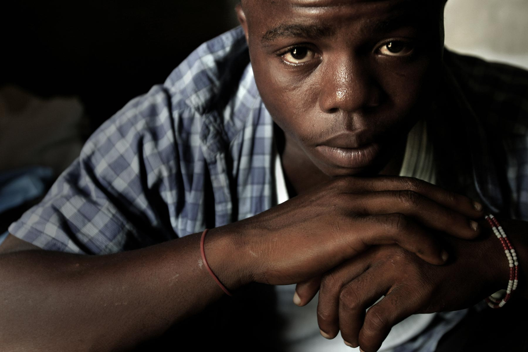 DECEMBER 1, 2006 MONROVIA, LIBERIA Former child soldier Momo Dukoe, 17, poses in Monrovia, Liberia on Dec 1, 2006. Momo, who was forcefully recruited to the government militia in his village in Lofa, northern Liberia when he was 11 years old, has fought for several years during the country's civil war which ended in Aug 2003. Photo by Kuni Takahashi