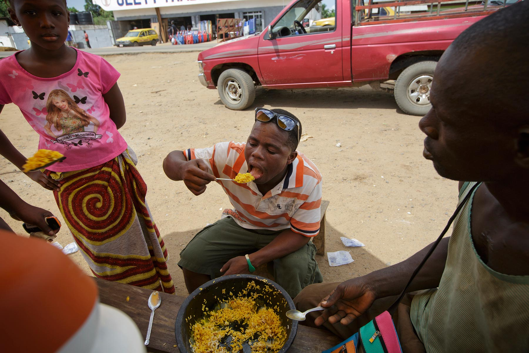 MAY 29, 2015 MONROVIA, LIBERIA Former child soldier Momo Dukoe, 25, eats lunch in Monrovia, Liberia on May 29, 2015. Momo, who was forcefully recruited to the government militia in his village in Lofa, northern Liberia when he was 11 years old, has fought for several years during the country's civil war which ended in Aug 2003. Photo by Kuni Takahashi