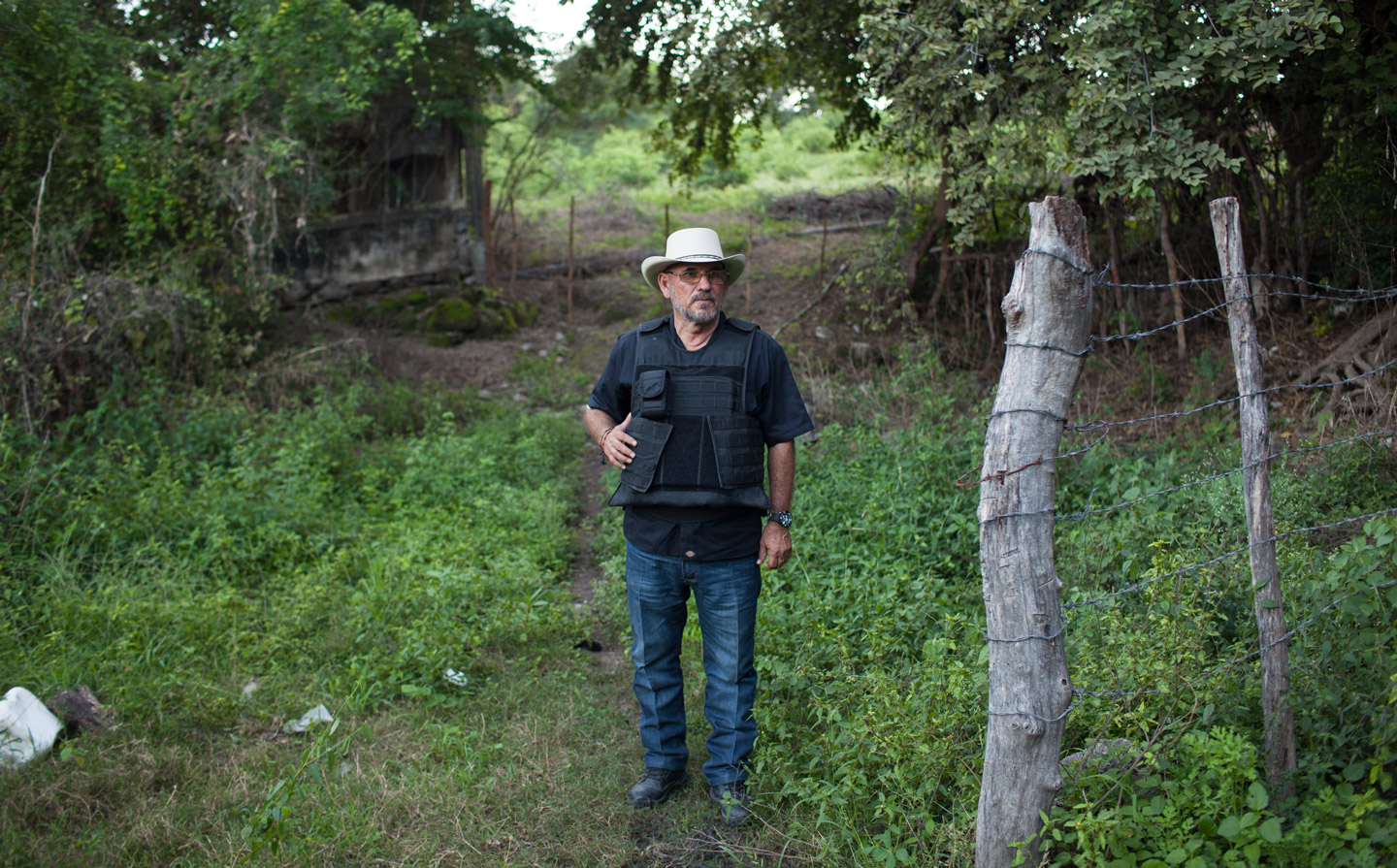 "Hipolito Mora at his families lime ranch in La Ruana, Michoacán, Mexico, Tuesday, December 15, 2015. Hipolito Mora was one of the original founder of the autodefensa movement, which saw vigilantes spread across the state of Michoacán and drive out the cartel group the 'Knights of Templar'. Since the uprising began in 2013, other criminal groups have filled the space of the previous cartel and many look at the autodefensa movement as a failure. Mora has had many challenges over the last three years, including being sent to jail twice and having his son killed in a shootout Dec. 16, 2014 during a shootout with a rival group. This ranch is a very important place for Mora. ""This is where I expect to die"" said Mora, motioning to the hills surrounding the ranch, which would make for a great spot for a shooter to hide. ""My son and I had plans to build up the house and make this out place, it was out dream, but that was before."" (Brett Gundlock/Boreal Collective)"