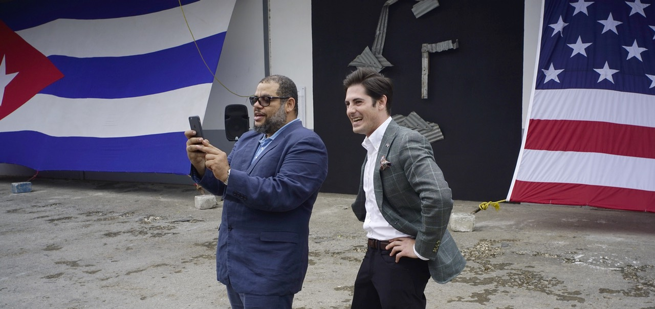 Google's head of Cuba operations, Brett Perlmutter, right, and Alexis Leiva Machado, a Cuban sculptor known as Kcho, take a selfie at the entrance of a new Google technology center in Havana, Cuba, Monday, March 21, 2016. The U.S. technology giant has built a studio equipped with dozens of laptops, cellphones and virtual-reality goggles at the complex run by the Cuban artist. The studio will be open five days a week, from 7 a.m. to midnight, for about 40 people at a time, Kcho said. (AP Photo/Ramon Espinosa)