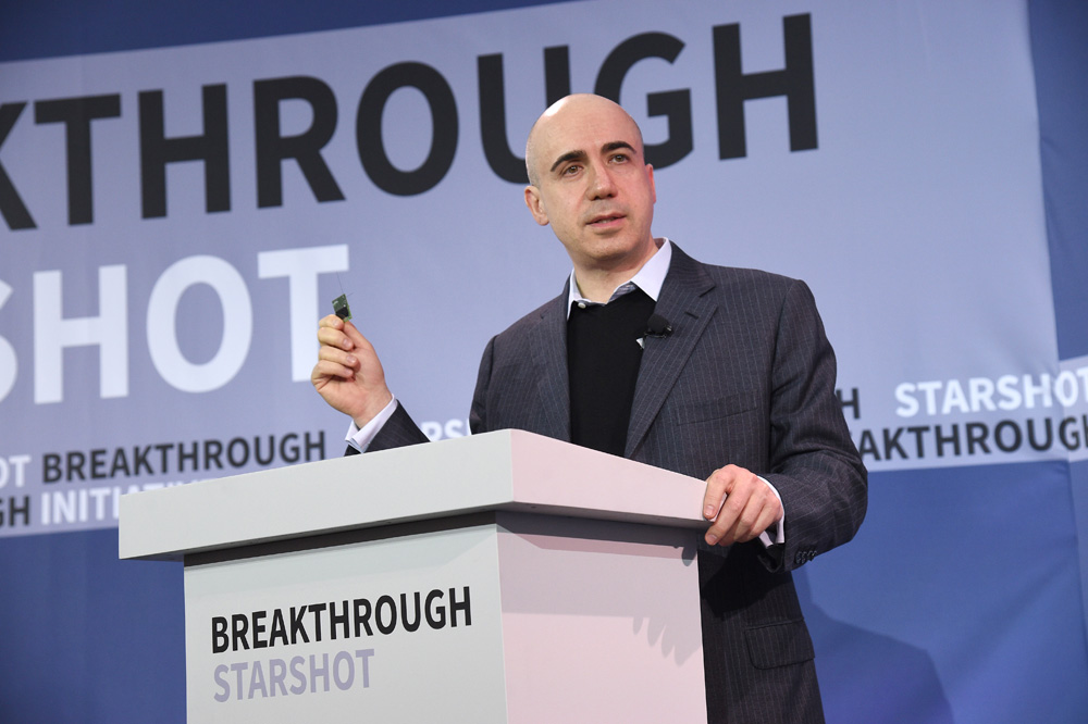 NEW YORK, NEW YORK - APRIL 12: Yuri Milner, Breakthrough Prize and DST Global Founder, demonstrates a new chip on stage as Yuri Milner and Stephen Hawking host press conference to announce Breakthrough Starshot, a new space exploration initiative, at One World Observatory on April 12, 2016 in New York City. (Photo by Bryan Bedder/Getty Images for Breakthrough Prize Foundation) *** Local Caption *** Yuri Milner