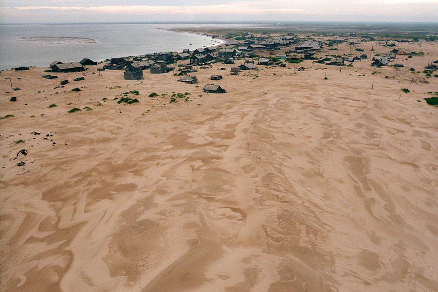 More than half of settlement already buryed under sandy dunes coming from the West Aug. 2005