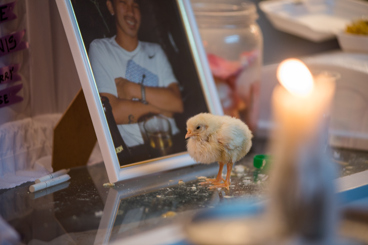 "A chick symbolizing a call for justice walks on Eric Sison's coffin. Sison, a rickshaw driver, was killed as he was surrendering in a ""routine anti-criminality patrol"" by Pasay Police on August 23 in Tramo, Pasay City."
