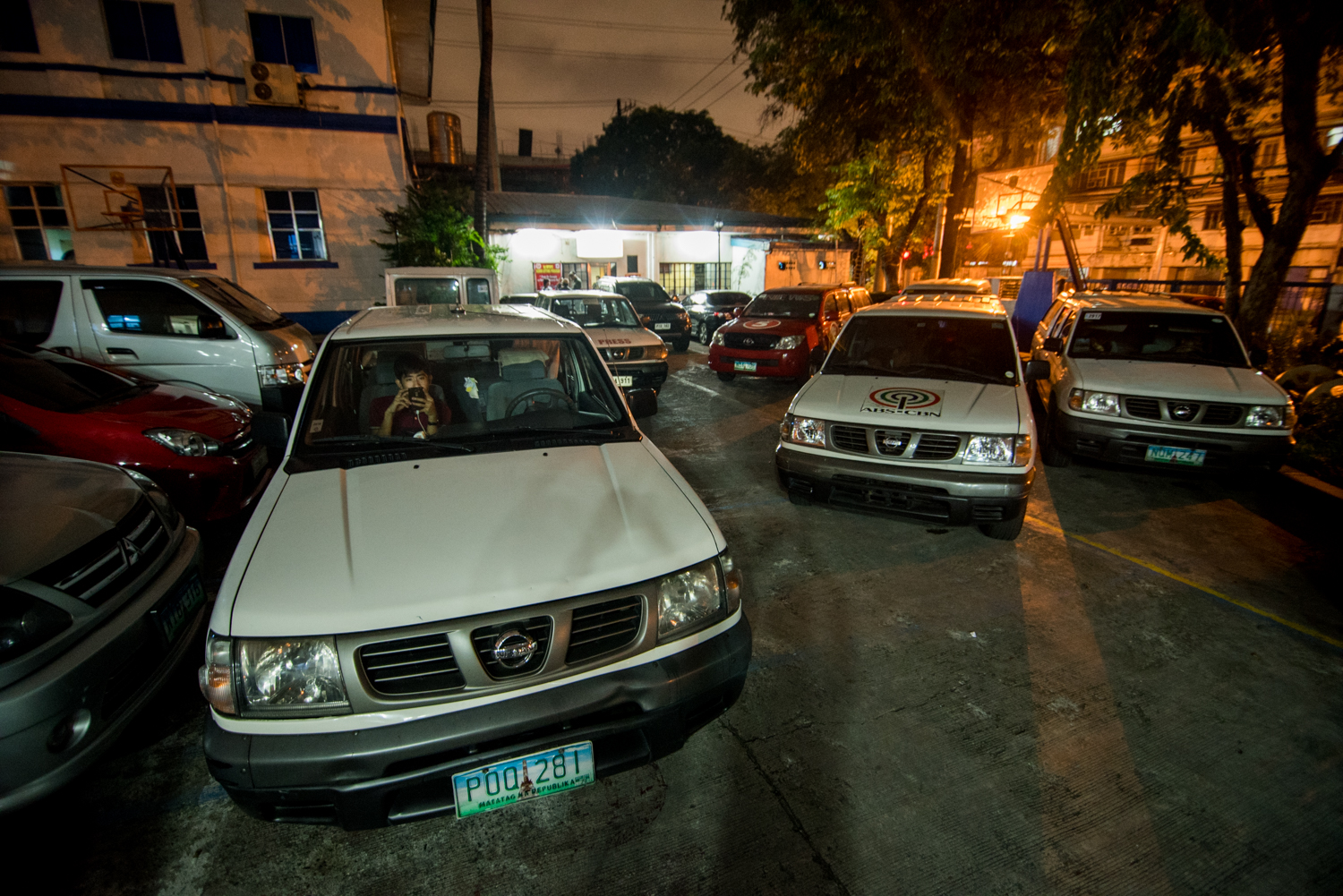 Vehicles of different media organizations on alert awaiting the next killing report of the night, August 25, at the Manila Police District Headquarters in Manila City, Philippines. The night shift duty for reporters had been full and busy since President Rodrigo Duterte sat to power on July 1.